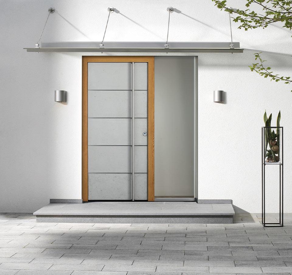 Porte d'entrée en béton argenté chez marx Holzhandel à Appenweier